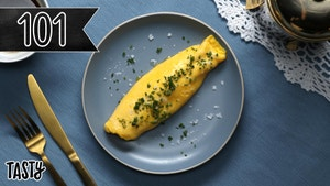 Yellow Omelet displayed on a set, blue table