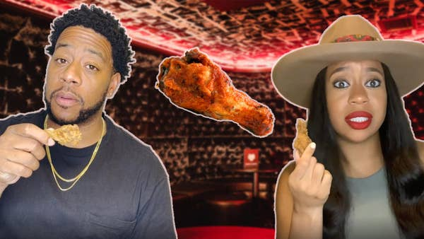Omari and Nikki holding up a chicken wing.