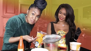Kayline holding Cheetos next to photo of Saweetie.
