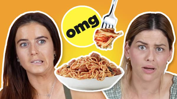 Tanika and Vikki both look competitive, with a bowl of pasta between them and a fork twirling spaghetti.