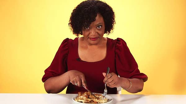 Upset women cutting into chicken and waffles