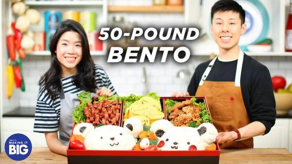 Alvin and Inga pose with a 50-Pound Bento Box.