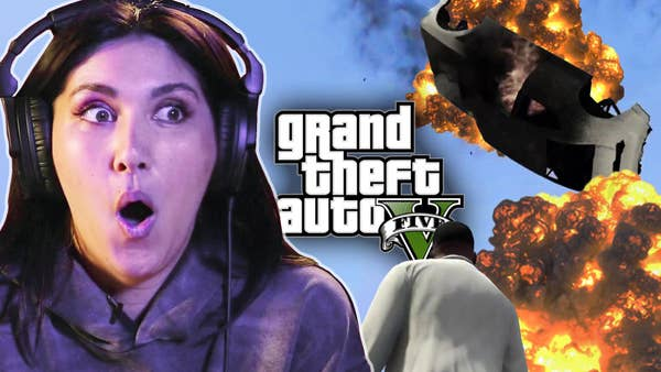 Sydnee looks shocked in front of an explosion from GTA V