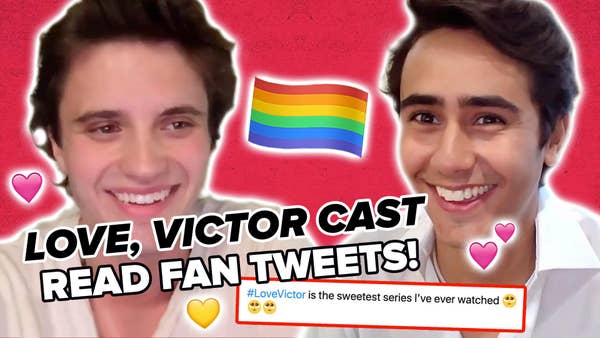 George Sear and Michael Cimino face each other. The title text reads Love Victor cast read fan tweets and a tweet appears below with heart stickers and a rainbow flag sticker.