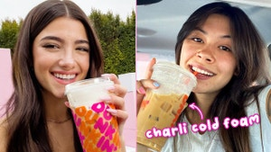 Charli D'Amelio is holding a Dunkin' Donuts coffee next to Mei who is holding the Charli Cold Foam drink.