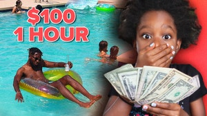 Lynnn holding $100 next to her father Andrew in swimming pool.