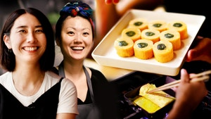 Rie and Jihee with rolled eggs on a plate.