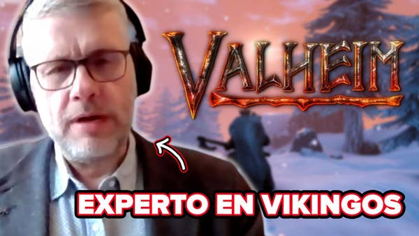 Anders reacts in front of a Viking video game character